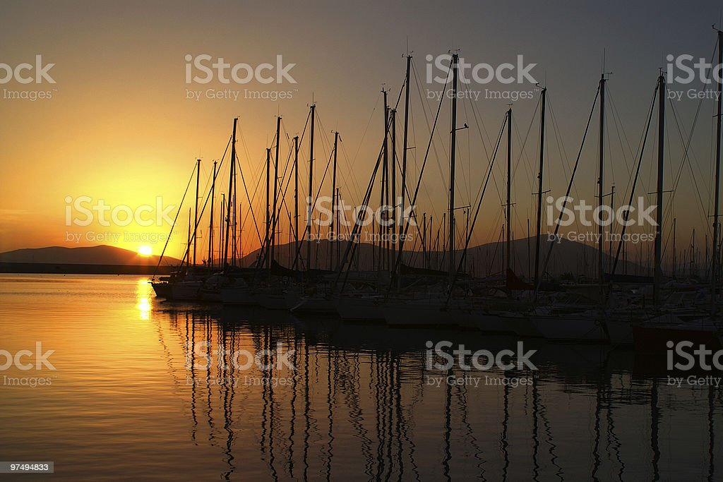 Sunset in a harbor. royalty-free stock photo