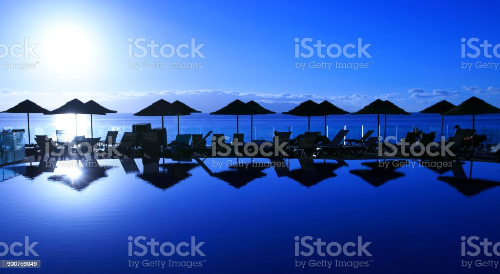 Sunset in a swimming pool stock photo
