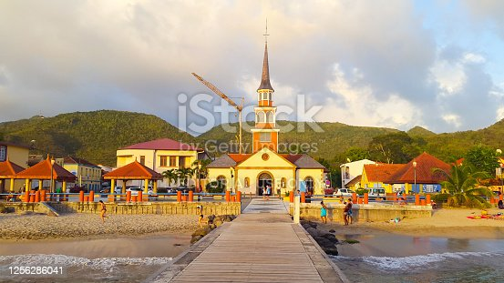 In March 2015, tourists could admire a beautiful sunset on the church of Anse d'Arlet in Martinique.