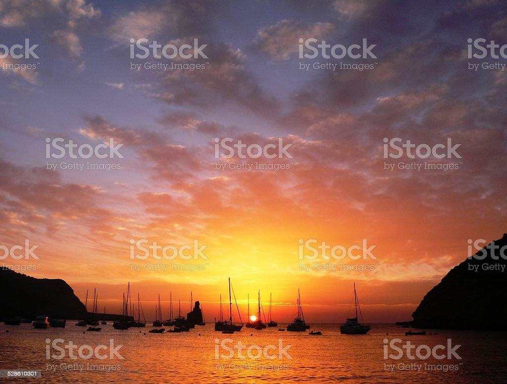 Sunset in Benirras beach in Ibiza stock photo