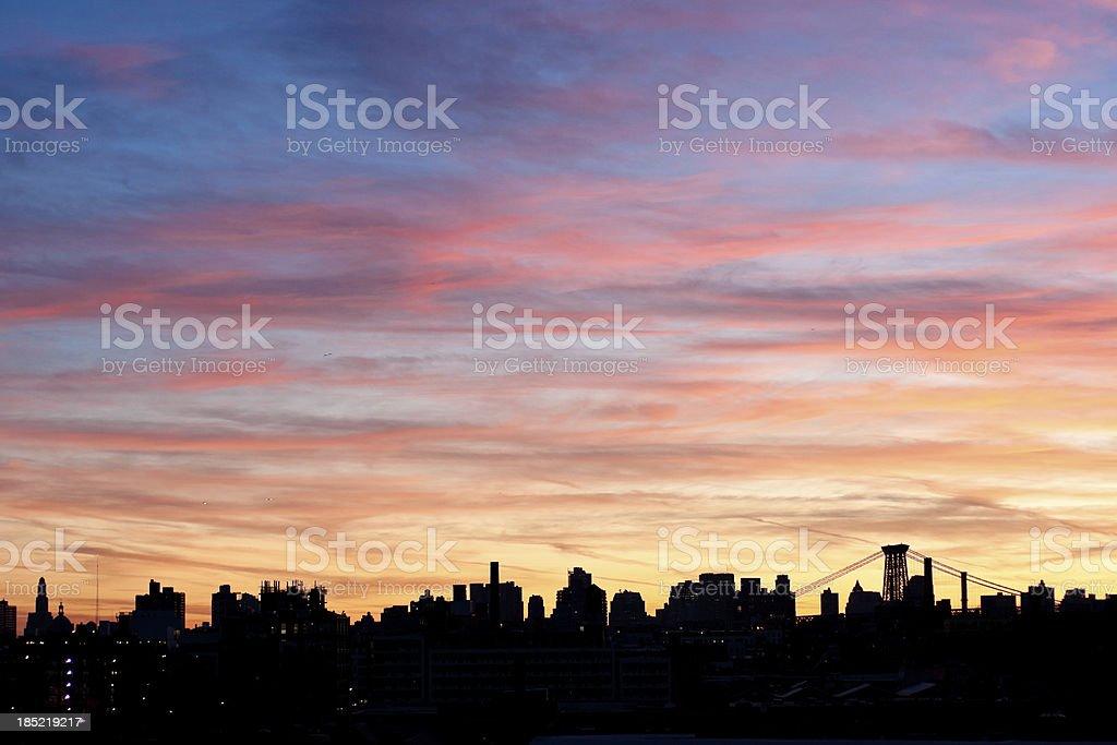 sunset in brooklyn overlooking manhattan skyline royalty-free stock photo