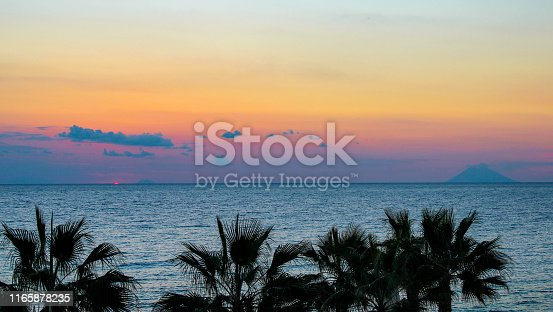 istock Sunset in Calabria with view on Stromboli 1165878235