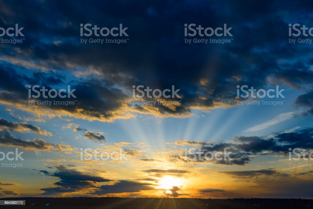 Sunset in clouds stock photo