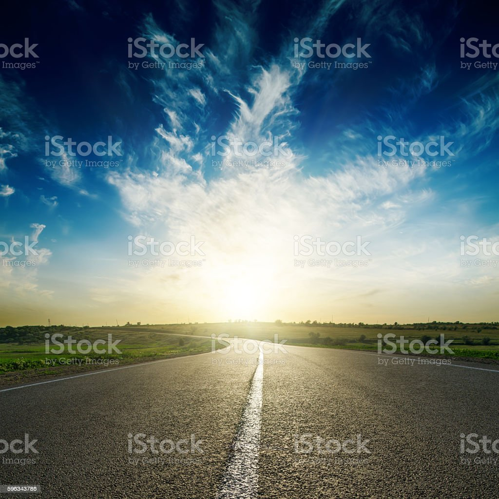 sunset in deep blue sky over road royalty-free stock photo