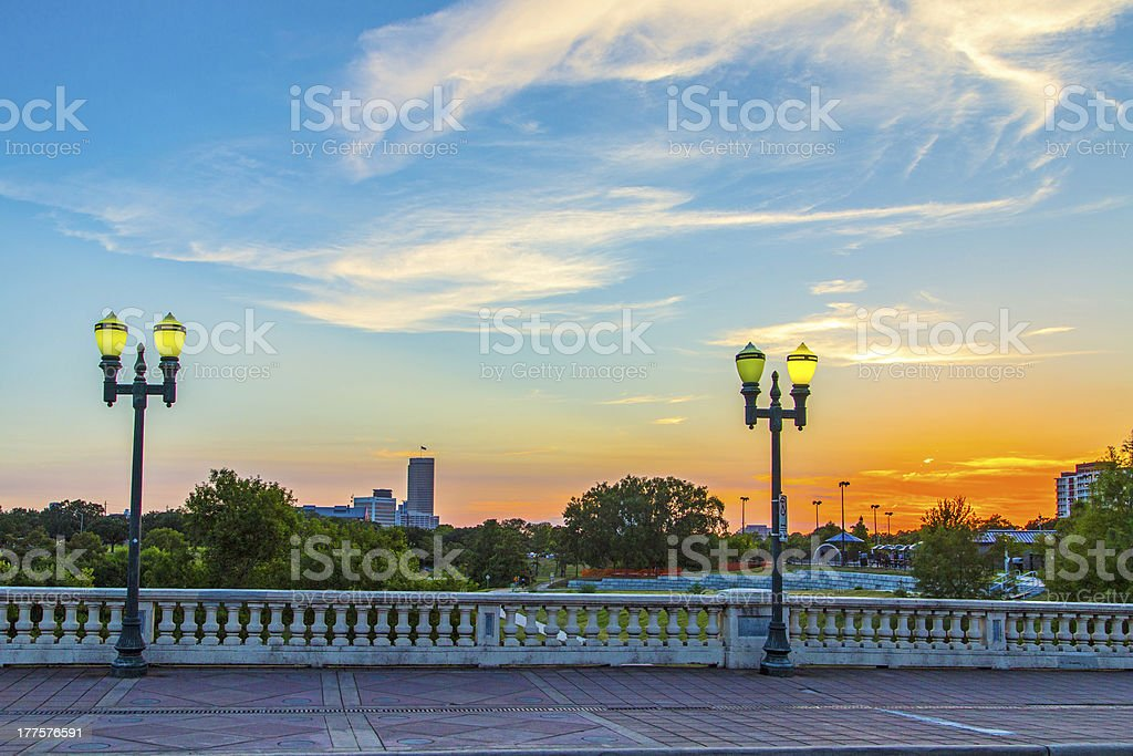 sunset in downtown Houston at a bridge stock photo