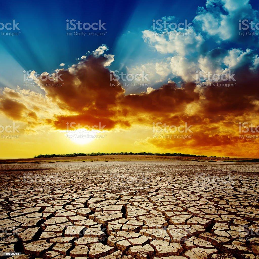 sunset in dramatic sky over desert stock photo