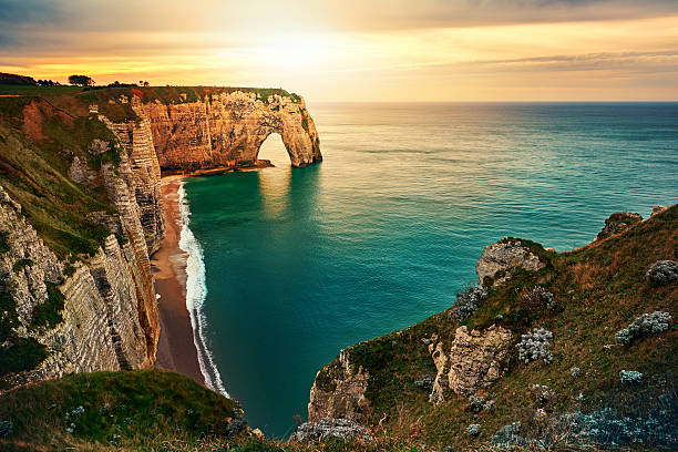 sunset in etretat - rocky coastline stock pictures, royalty-free photos & images