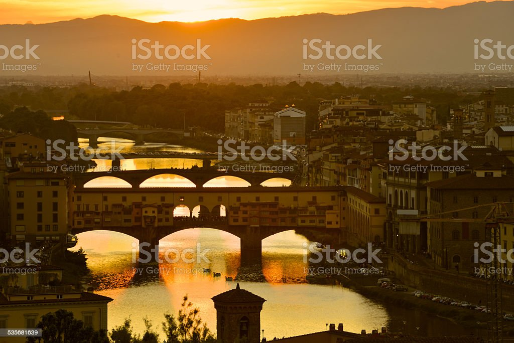 sunset in Florence Italy with the Old Bridge Arno river stock photo