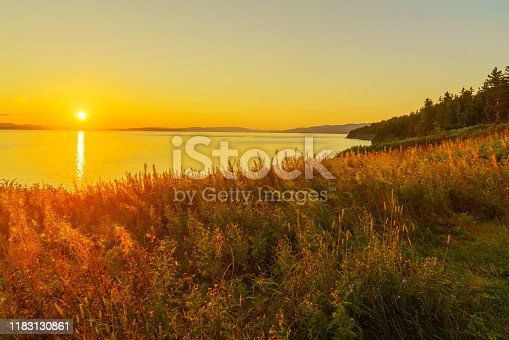 Sunset view of shore and ocean in the south sector of Forillon National Park, Gaspe Peninsula, Quebec, Canada