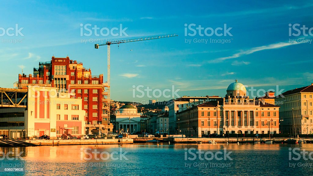sunset in front of the city of Trieste stock photo