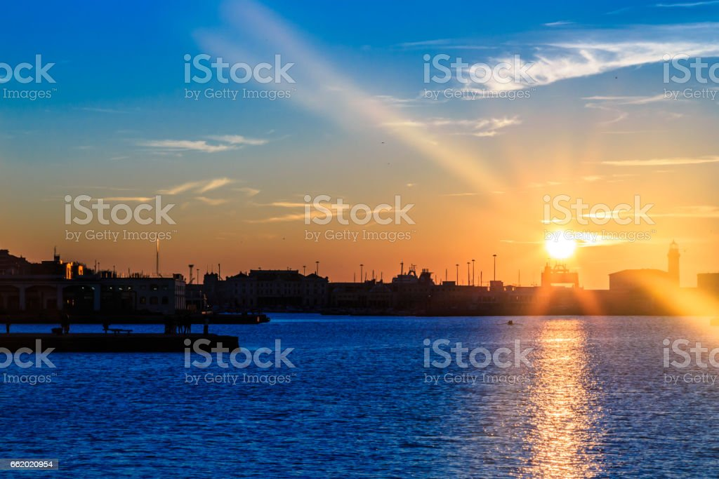 sunset in front of the city of Trieste royalty-free stock photo