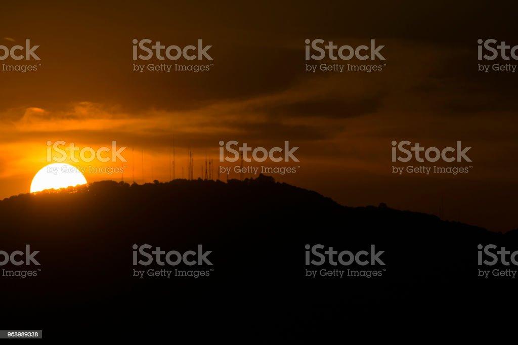 Sunset in Guatemala, mountain silhouette, communication antenna.