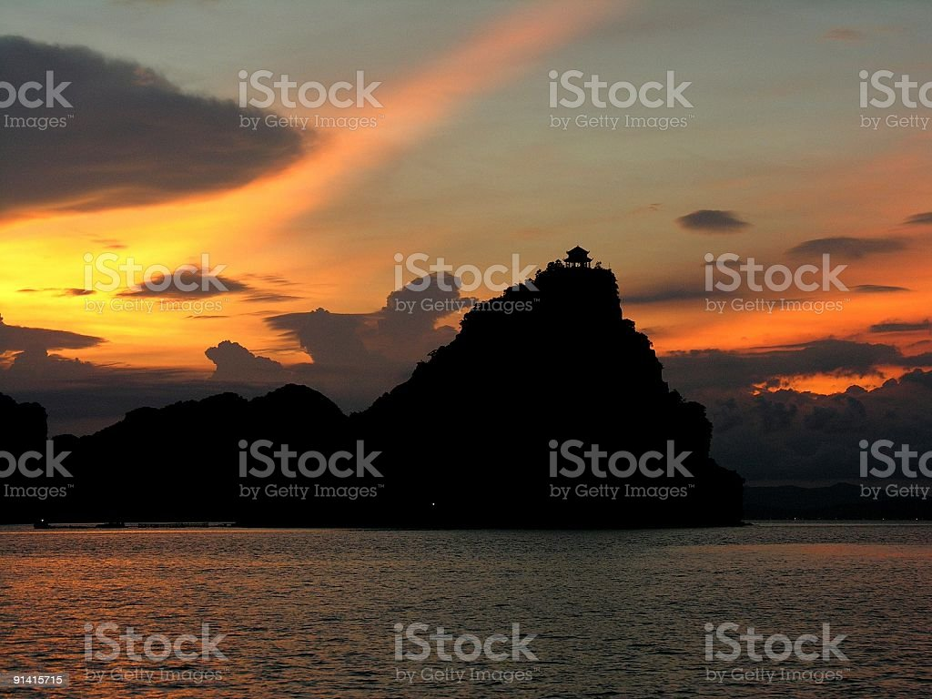 Sunset in Halong Bay with buddhist temple royalty-free stock photo