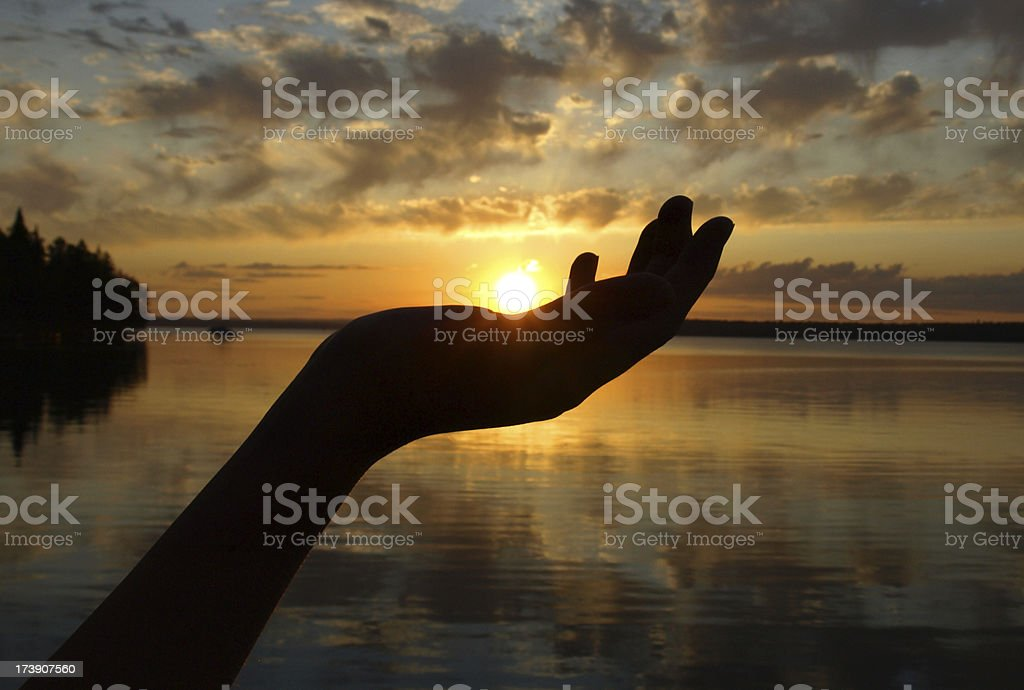 Sunset in Hand over Lake stock photo
