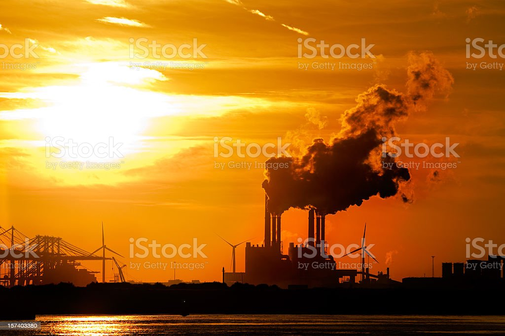 Sunset in industrial area. stock photo