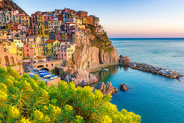 sunset in manarola, cinque terre, italy - italy stock photos and pictures
