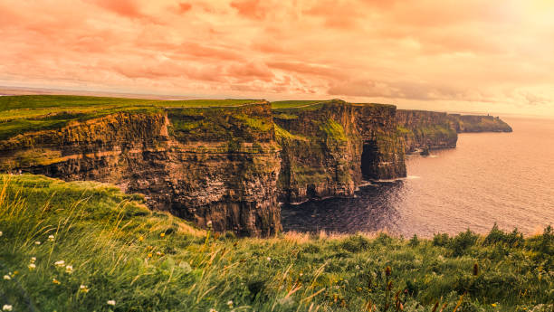 sunset in moher of cliff, ireland - county clare stock pictures, royalty-free photos & images