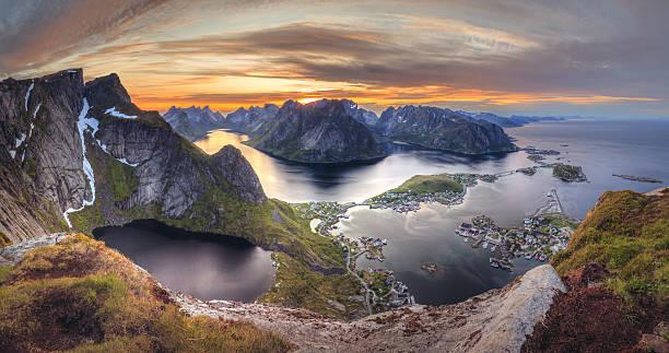 Sunset in Norway in Lofoten island:  Reinebringen - Reine town stock photo