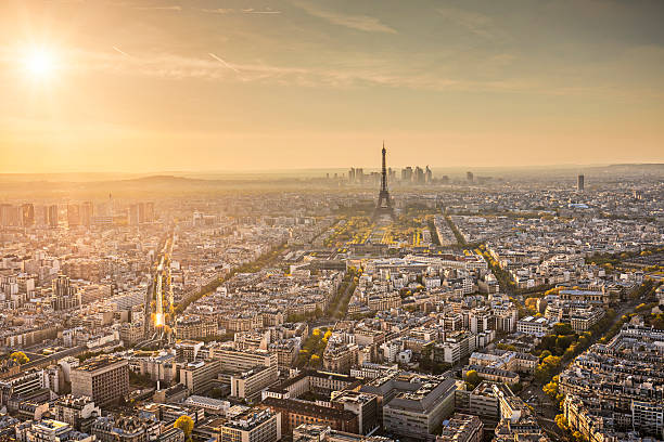Sunset in Paris Panorama view of Paris at sunset. ile de france stock pictures, royalty-free photos & images
