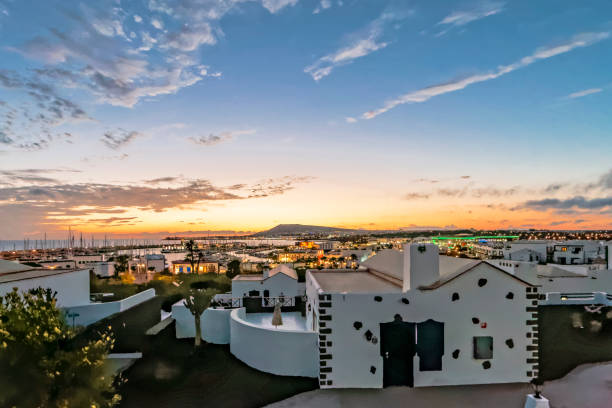 sunset in playa blanca on the canary island of lanzarote - wasser stock pictures, royalty-free photos & images
