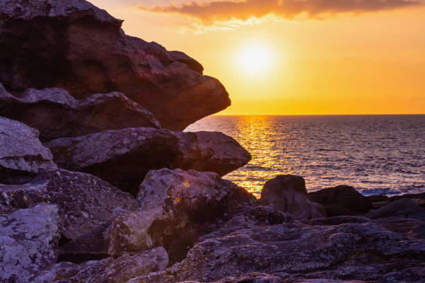 sunset in saint-guenole, brittany - rocky coastline stock pictures, royalty-free photos & images