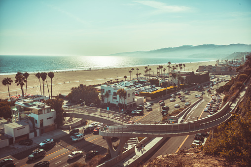 Sunset in Santa Monica, view on beach, pacific ocean and highway, soft focus and low contrast due to rimlight, monochrome vintage toned