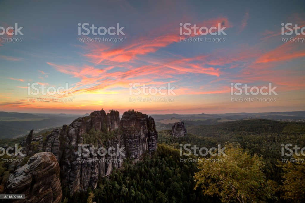 Sunset in Schrammstein, forests and colored sky in the Germany Switzerland. stock photo