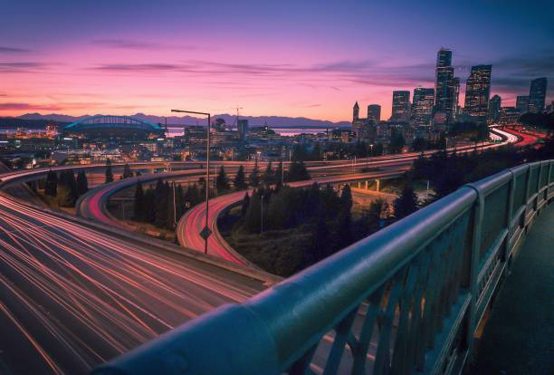 Sunset in Seattle Enjoying sunset with a view of Seattle skyline and Olympic mountains elevated road stock pictures, royalty-free photos & images