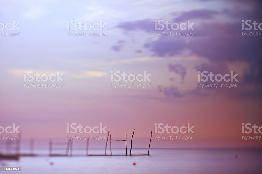 Sunset in small Mediterranean bay stock photo