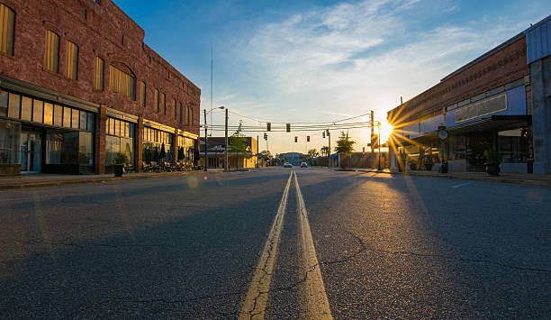 sunset in small town - town stock pictures, royalty-free photos & images