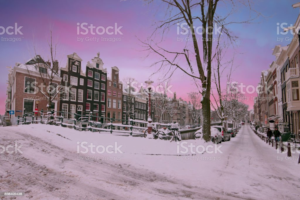 Sunset in snowy Amsterdam in the Netherlands in winter stock photo