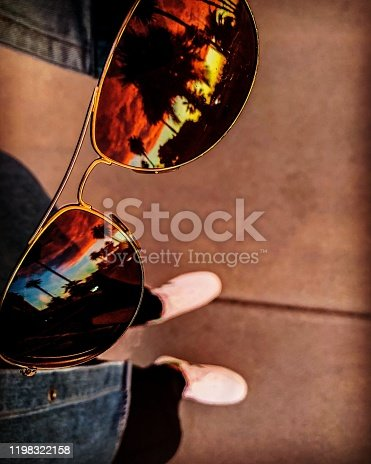 California sunset reflected in sunglasses