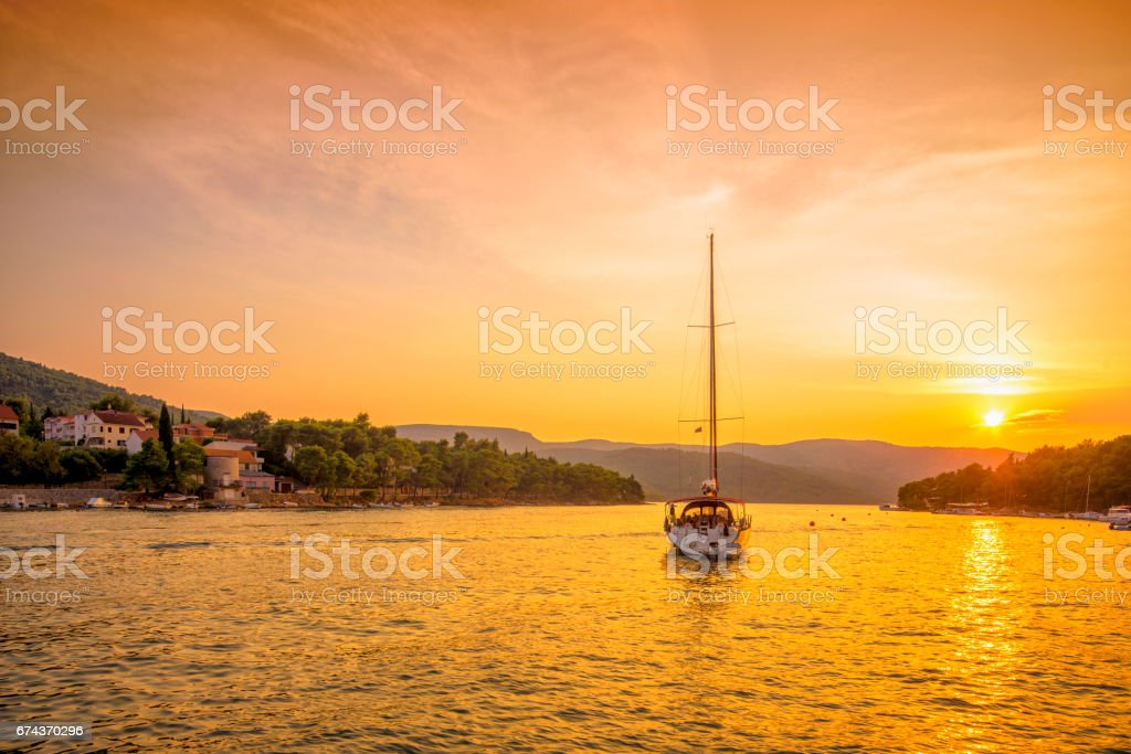 Sunset in the bay of Stari Grad, Hvar (Croatia) stock photo