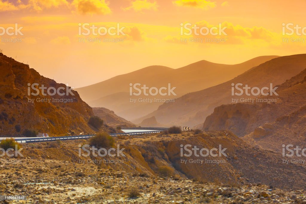 Sunset in the desert. Mountain road in the desert. View of the...