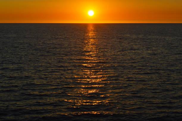 Sunset in the horizon stock photo