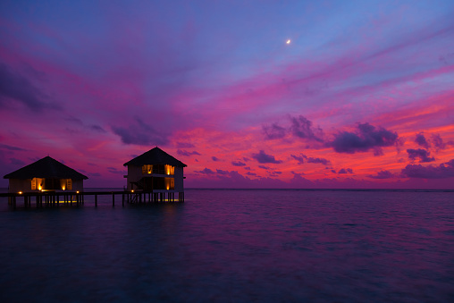 Sunset In The Maldives With A View Of The Bungalows Stock Photo - Download Image Now