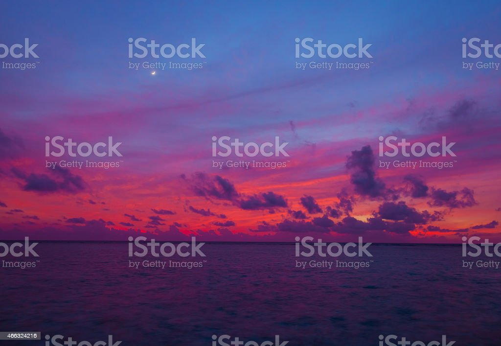 Sunset in the Maldives with a view of the lagoon stock photo