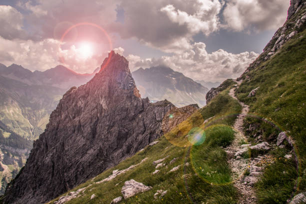 Sunset in the Mountains Narrow Mountain Path along a Steep Slope steep stock pictures, royalty-free photos & images