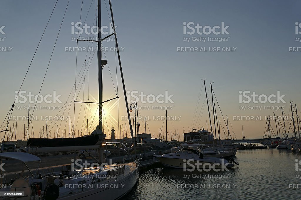 Sunset in the nautical smaller boats port stock photo