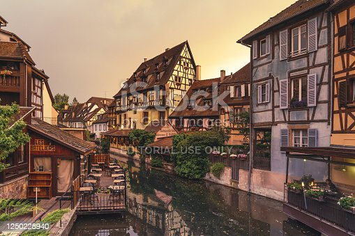 istock Sunset in the old town of Colmar along the channels of the Le Petit Venice, Alsace, France 1250228940