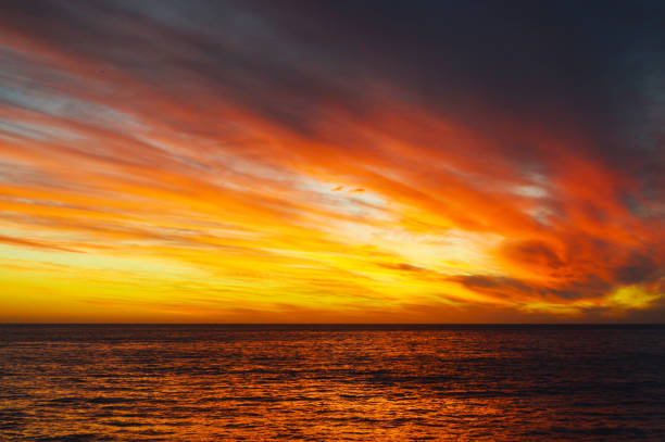 Sunset in the Pacific ocean stock photo