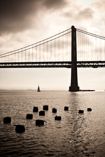 Sunset in San Francisco at the Bay Bridge with a lonely sailboat. More images from San Francisco in the lightbox: