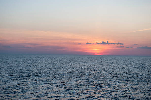 Sunset in the sea stock photo