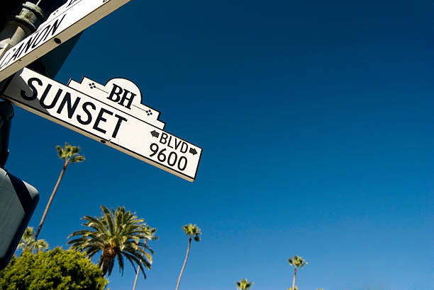 Sunset in the sky Sunset Blvd street sign in Beverly Hills.  sunset boulevard los angeles stock pictures, royalty-free photos & images