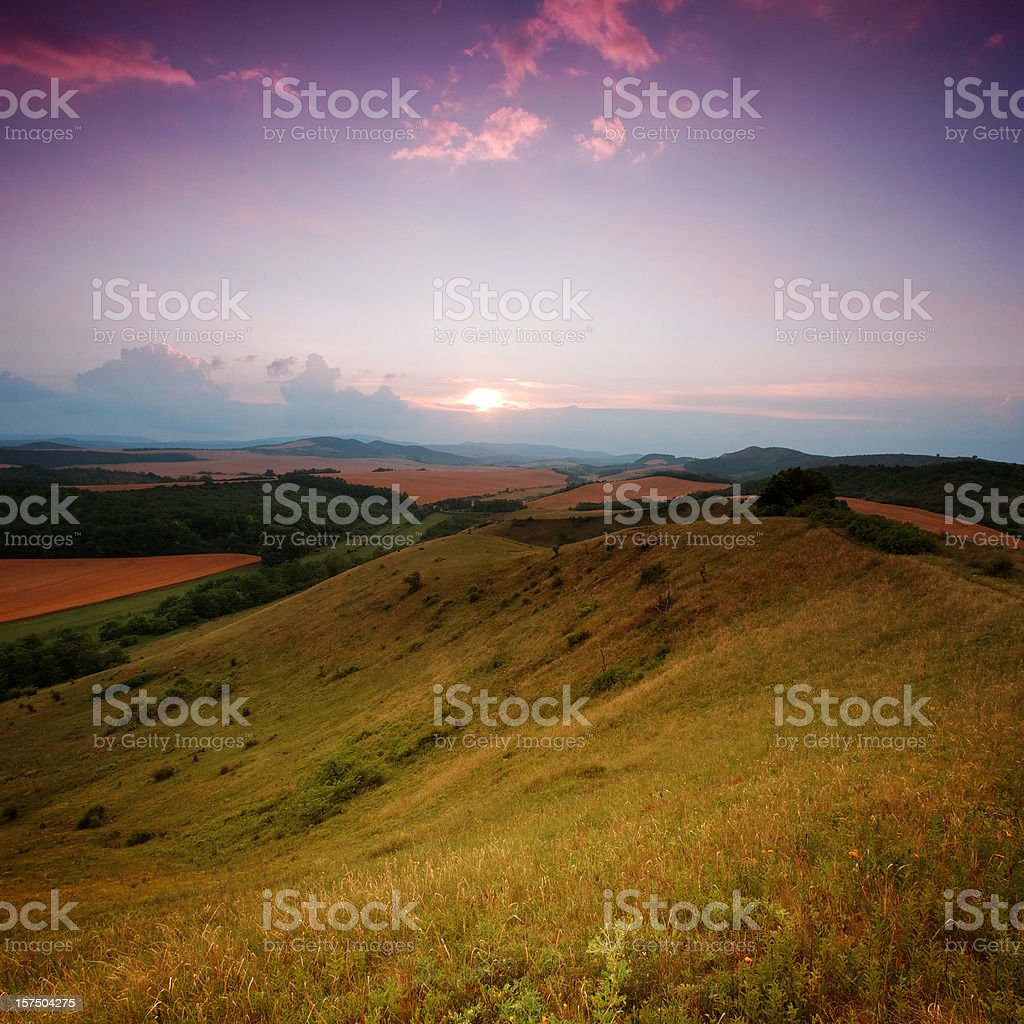 Sunset in the valley - view from a hilltop royalty-free stock photo