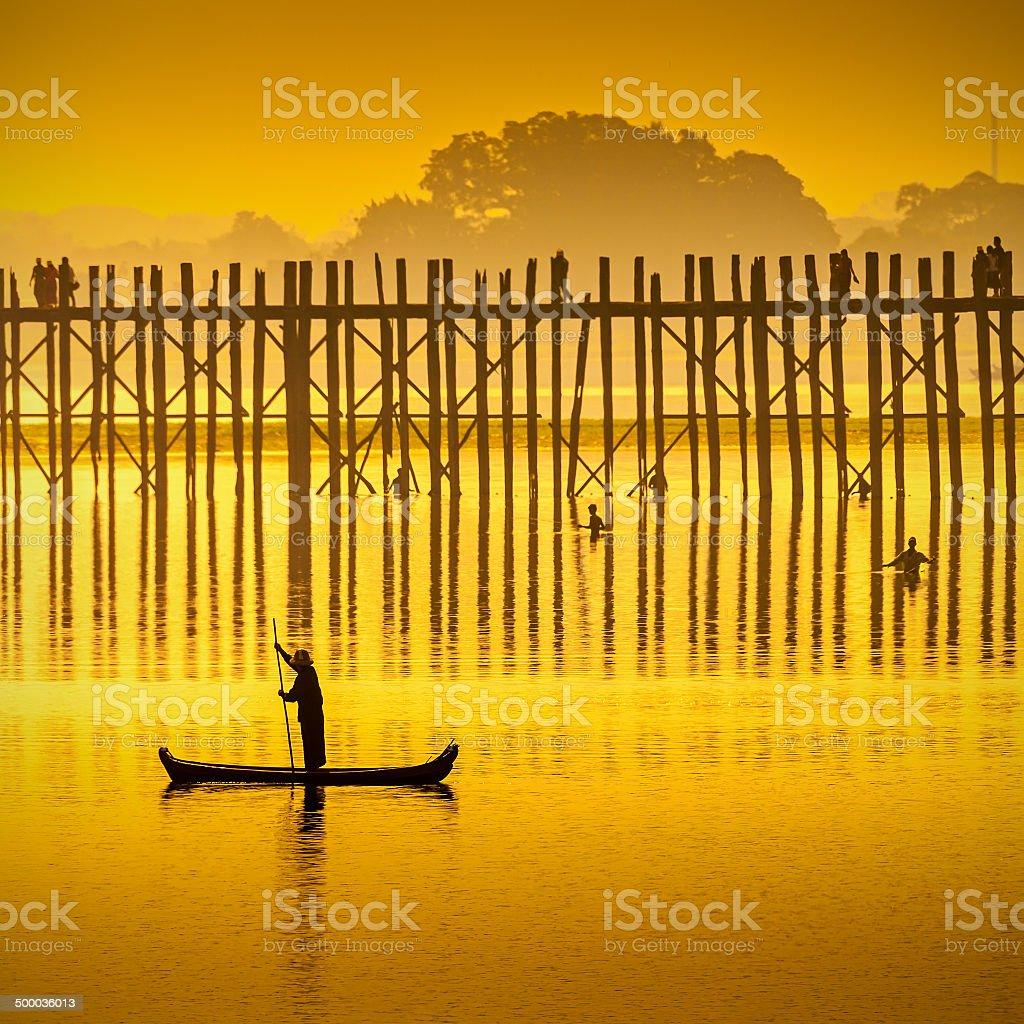 Sunset in U Bein bridge, Myanmar. stock photo