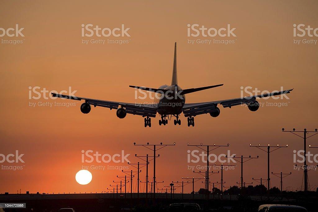 Sunset Jet Landing royalty-free stock photo
