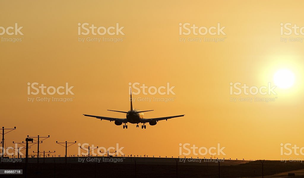 Atardecer Jet Landing foto de stock libre de derechos