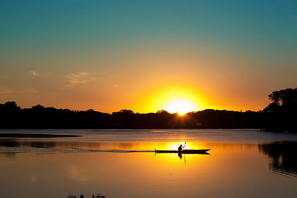 Sunset Kayaking in Lake of the Isles, Minneapolis, Minnesota stock photo