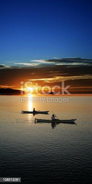 184332102istockphoto XXXL sunset kayaking 108313281